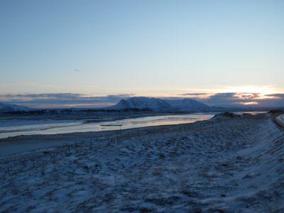 Walking along the icy black beach on Vatnsnes Peninsula